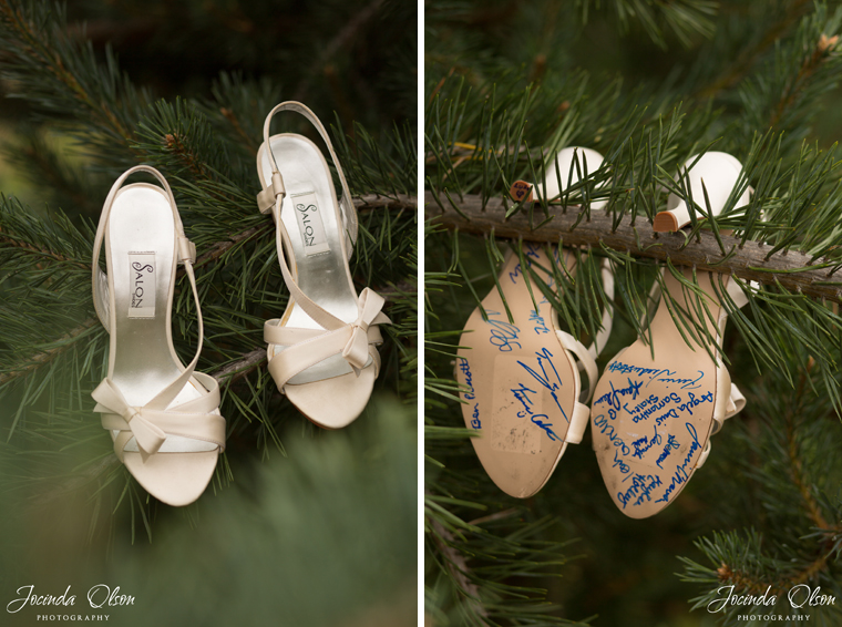 Wedding shoes with party signatures on the bottom