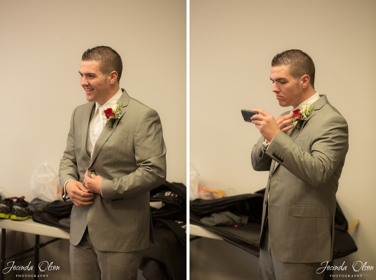 Groom putting jacket on and fixing tie