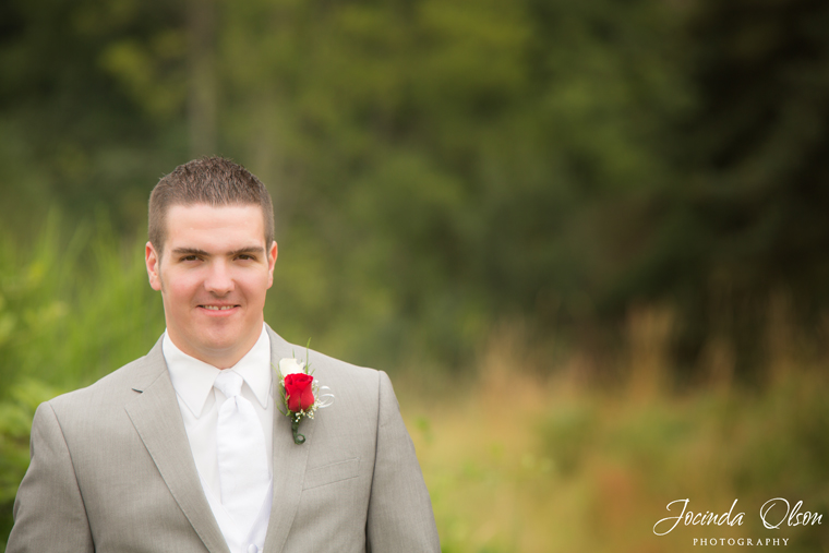 Groom with red rose