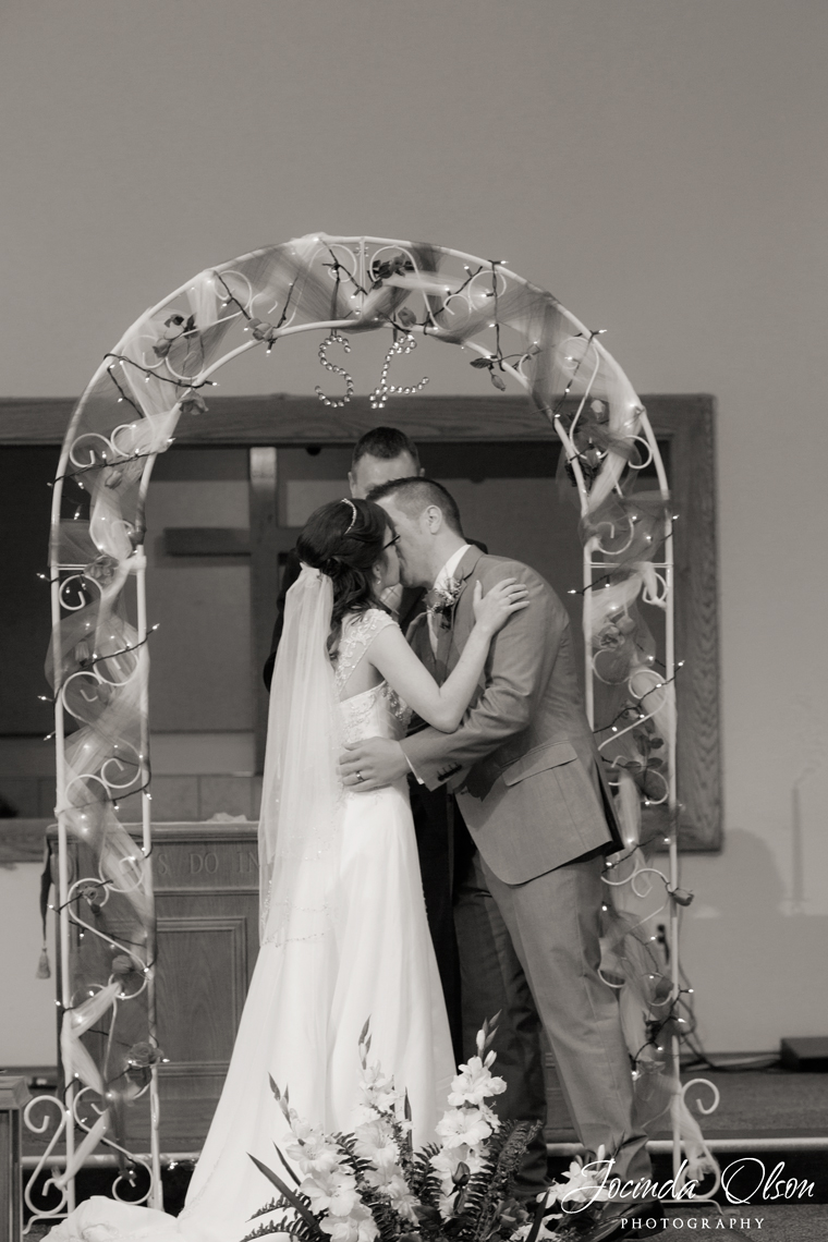 A bride and groom's first kiss.