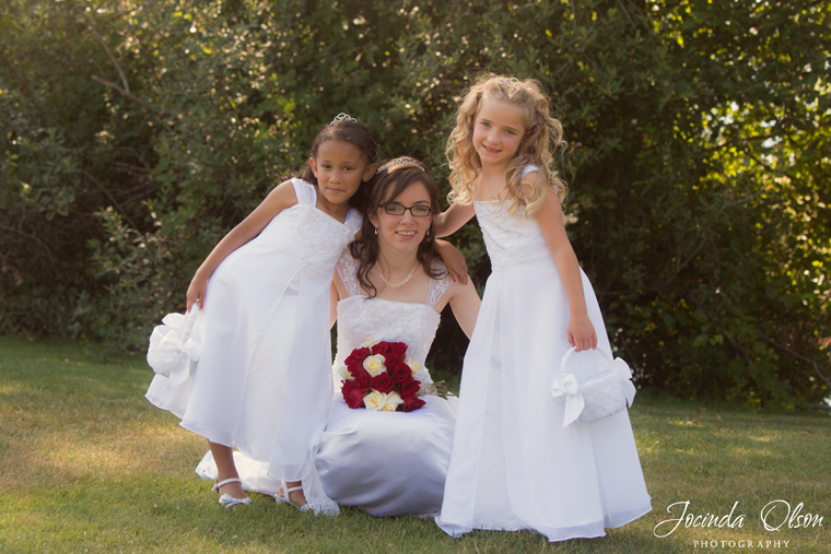 Bride with flower girls at Lake Meridian Park