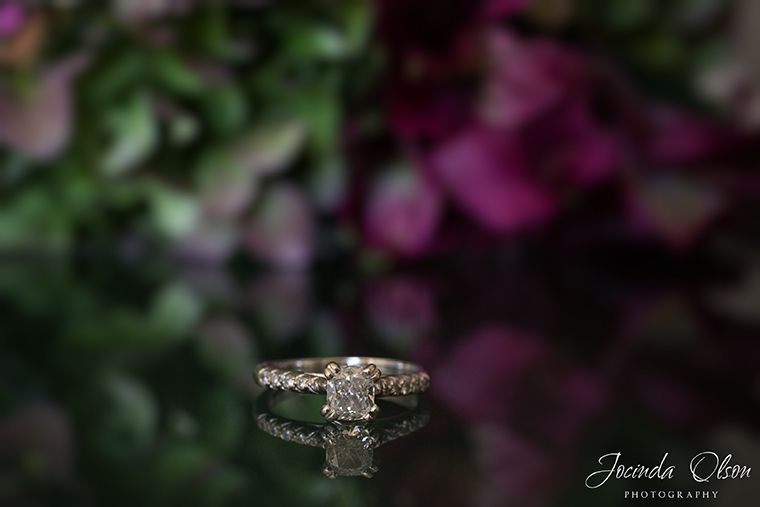 white gold engagement ring on reflective surface