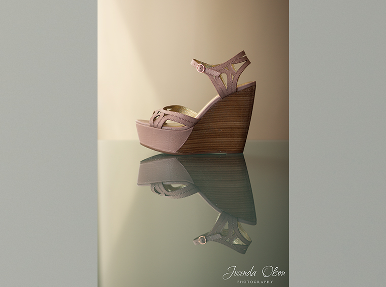 Pink wedge bridal shoes reflected in glass
