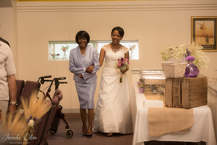 Bride and sister walking down the aisle