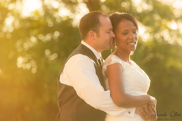 Bride and Groom portrait backlit with sun flare