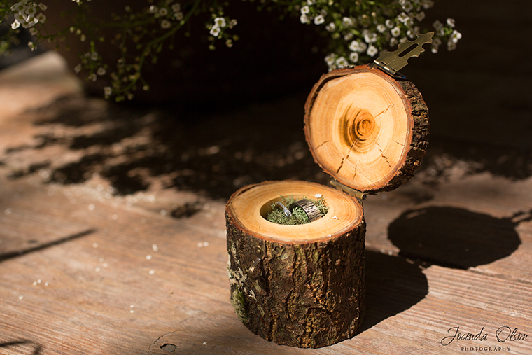 Rustic wedding rings in small wooden box