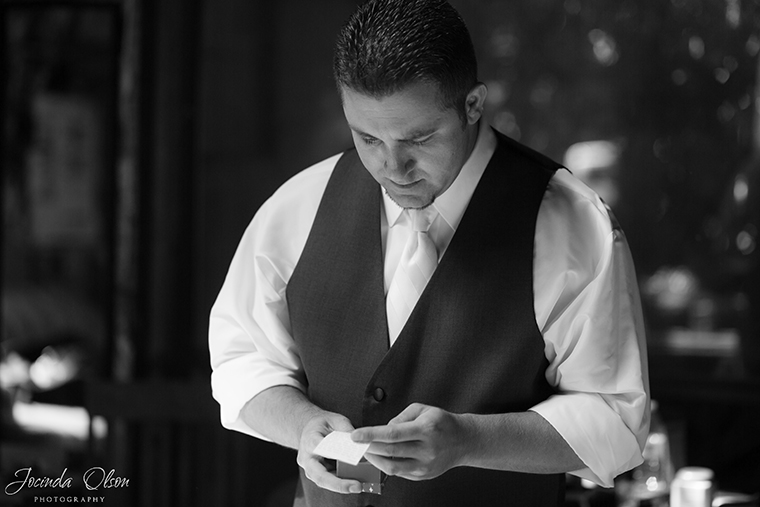 Groom opening up gift from Bride