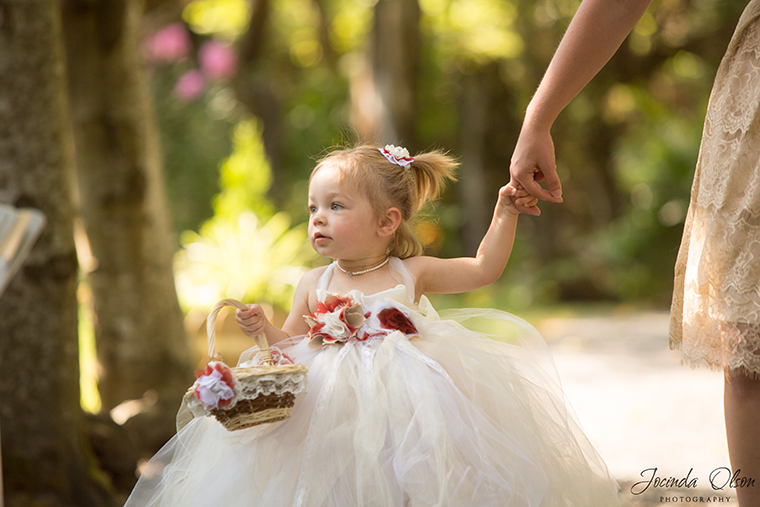 Flower Girl walking down the aisle at Maroni Meadow Venue