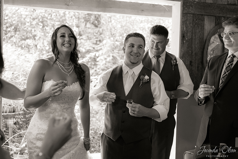 Bride and Grooms toast to bridal party after ceremony